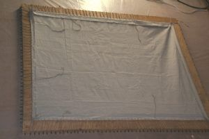 Sewing and tensioning of the new linen on the Spanish loom